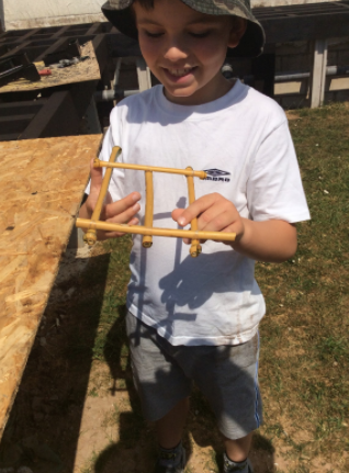 Isaac building his boat