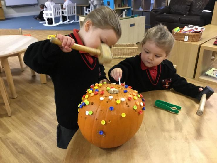 Pumpkin fun with hammers and pegs