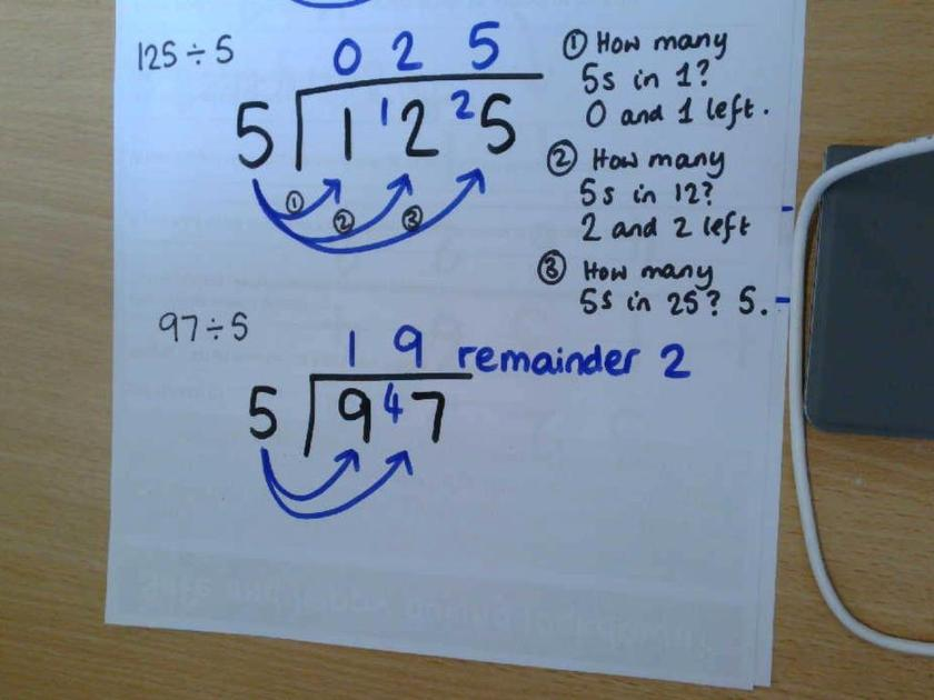 Example of using the bus stop to find 97 divided by 5 = 19 remainder 2