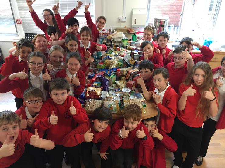 Class 5/6SB celebrating the huge amount of food donated through the Tins for Toys sale!