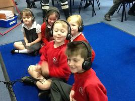 WE LOVE LOOKING AT BOOKS AND LISTENING TO STORIES ON OUR NEW HEADPHONES WHICH WE CHOSE USING OUR MONEY FROM FOBS. 3