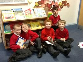 WE LOVE LOOKING AT BOOKS AND LISTENING TO STORIES ON OUR NEW HEADPHONES WHICH WE CHOSE USING OUR MONEY FROM FOBS. 1
