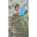 Kai read his book, buried.