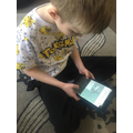 Callum completing his spellings (great top!)