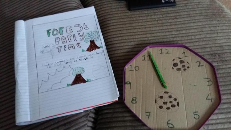 Making a clock out of a chocolate lid! Very creative Joseph.