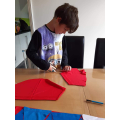 Joseph making bunting for VE day