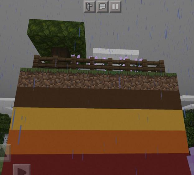 Niamh's rainy minecraft world showing the layers of the Earth