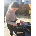 Lauren planting in the garden