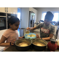 Sukhpreet and her brother making a cake!