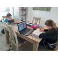 Lauren working hard at home with her sister