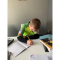 Cam working hard on his Maths!