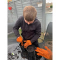 Cam planting his seeds! Lots of mess = lots of fun