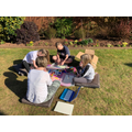 The whole family doing some art in the garden
