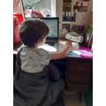 Joseph working hard on his writing