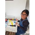 Jasmine working hard on her artwork