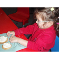 Decorating the biscuits we made.