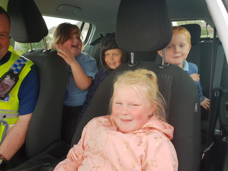 Trying out the inside of the police car.
