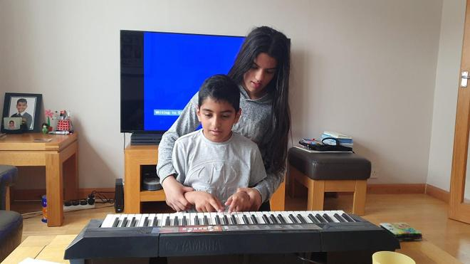 Sibling help learning the piano