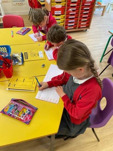 Year 1's Practising their handwriting
