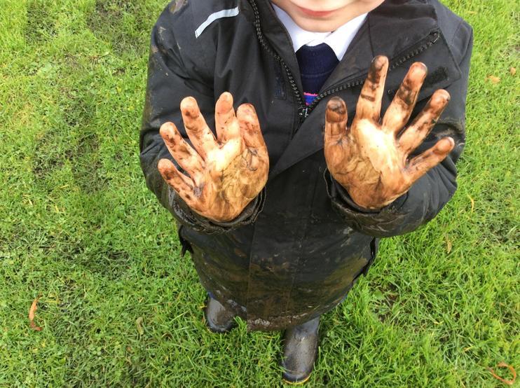 Muddy hands is so much fun.