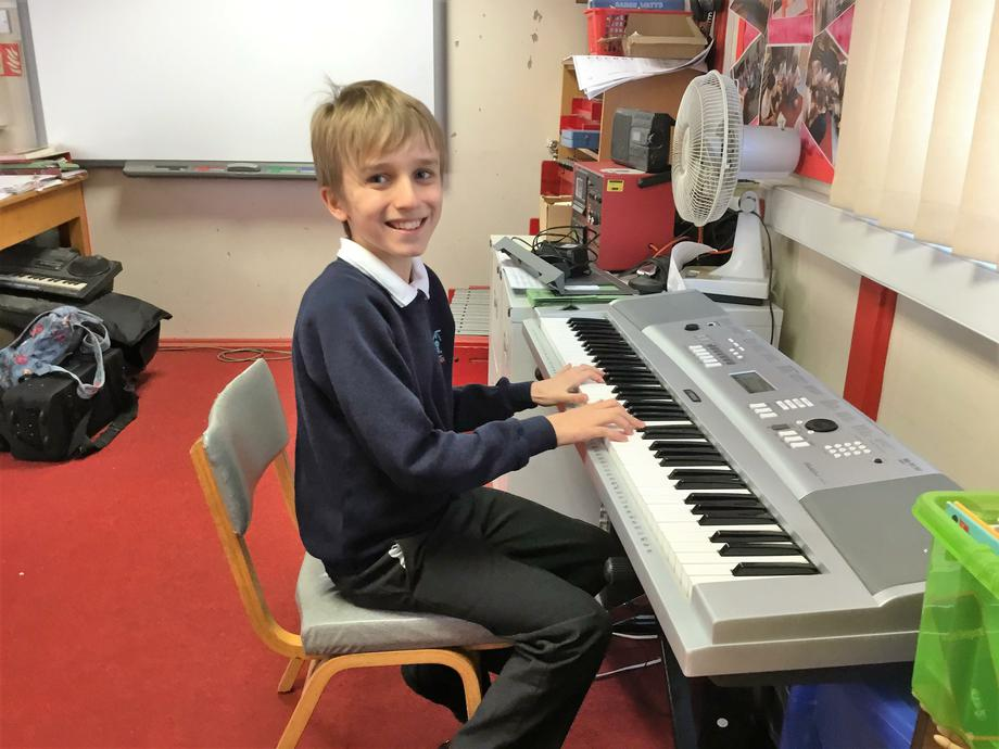 Year 6 pupil working for grade 3 piano