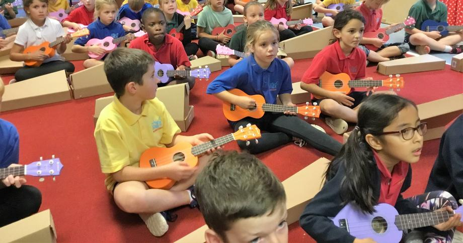 Year 4 Ukulele lesson. Thanks to B.F.G. for funds.
