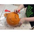 Halloween fun carving pumpkins.