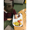 Making a yummy fruit salad for snack.