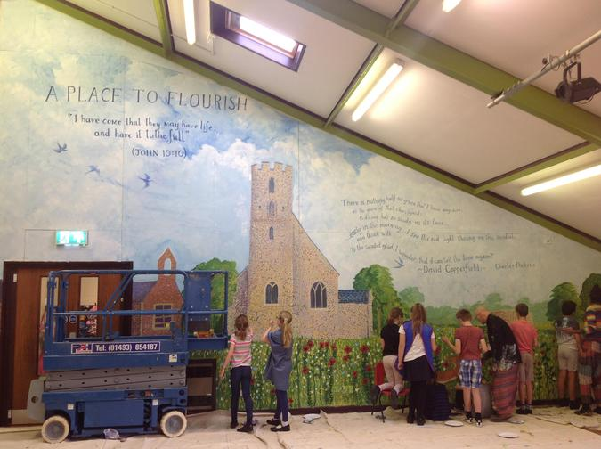 Our beautiful hall mural created by the children