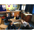 P3 boys cunstructing the walls of a House