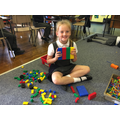 A P3 building her wall of her detached home.