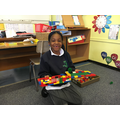 A P3 creating her dream house.