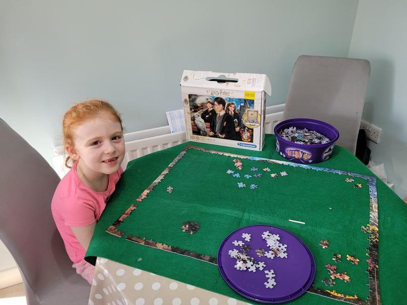 Grace starting a very big jigsaw