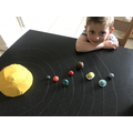 A fantastic solar system made from clay.