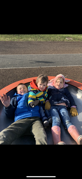Eli having fun with his brother and sister