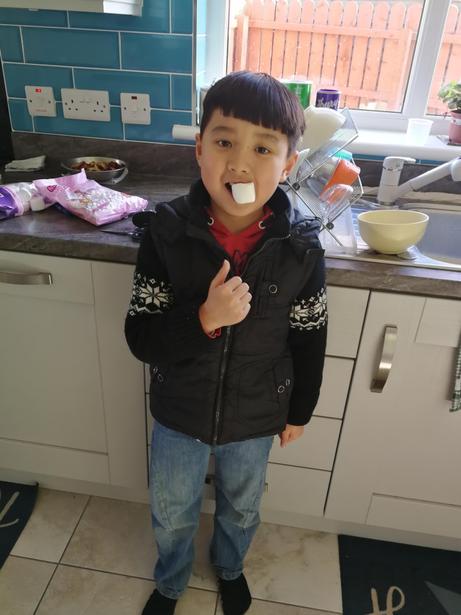 Austin enjoying a marshmallow