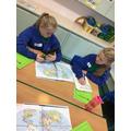 using lines of latitude and longitude