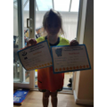 Starla has certificates for working hard.