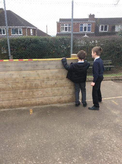 Working out the perimeter and area of the playground equipment.
