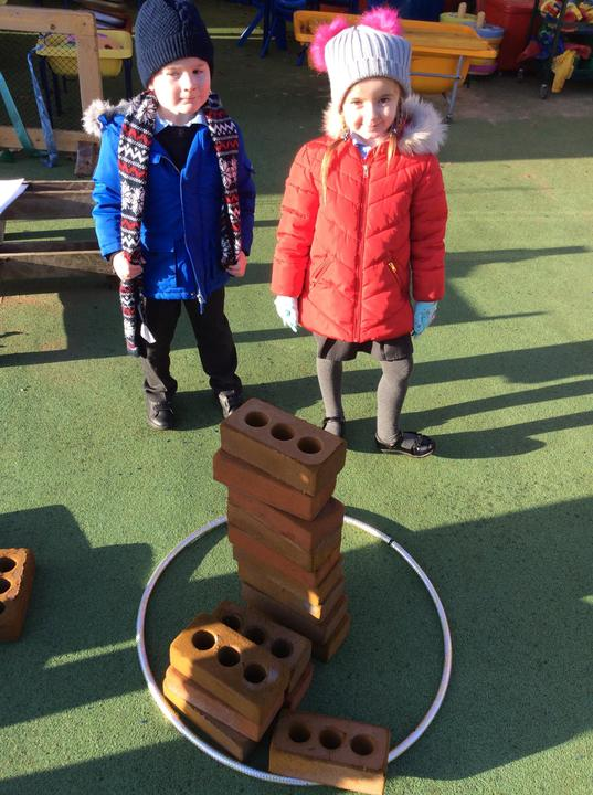 Outdoors - comparing heights of brick towers