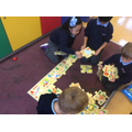 Getting busy with our alphabet jigsaw