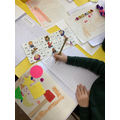 Using jolly phonics sound mats to support with writing in an English lesson.
