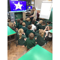 Children modelling the action for phonemes.