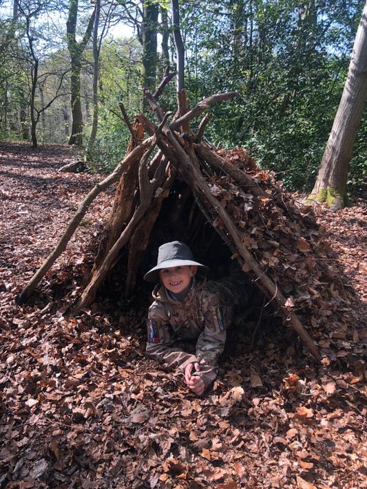 CJ (2N) has been building int the woods
