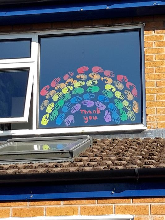 We made a rainbow on our window using hand prints