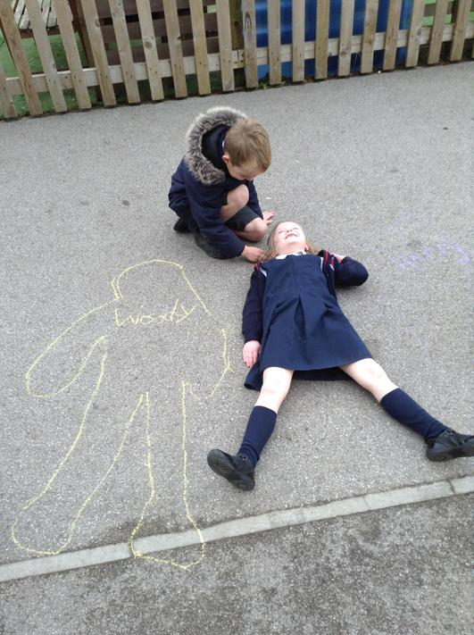 Drawing around our partners in chalk