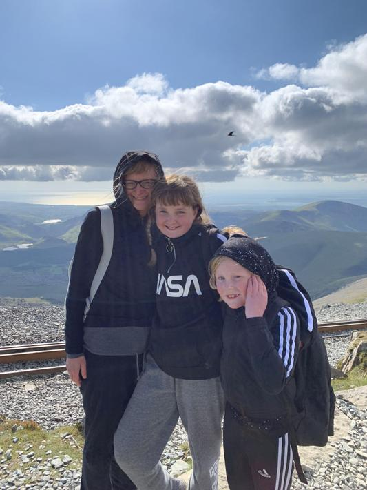Here is Mrs Thompson at the summit of Mt Snowdon