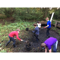 Digging out the sludge by the St Peter's scouts