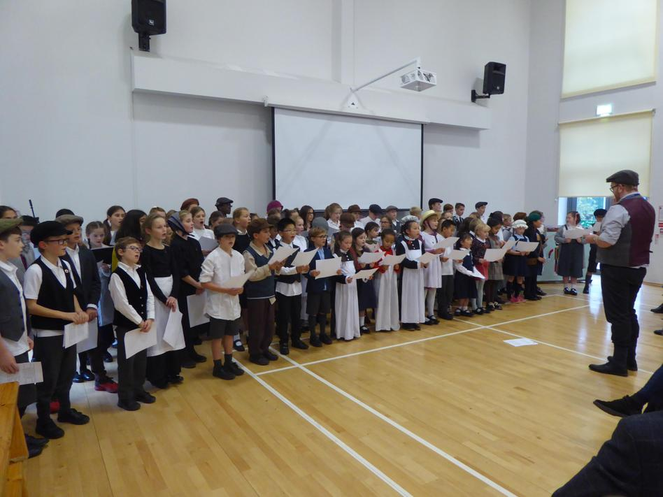 The Junior Choirs singing for our guests