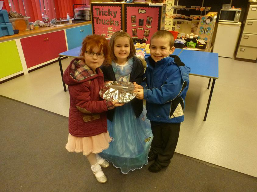 Taking fairy cakes over to pre-school.